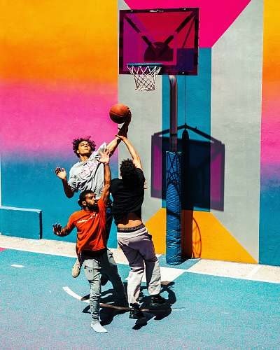human three people playing basketball people