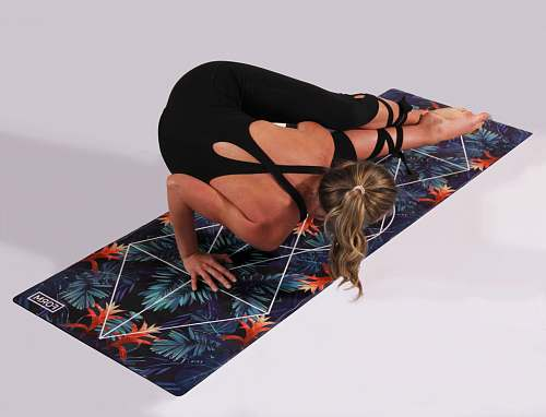 human woman dosing yoga on multicolored yoga mat people
