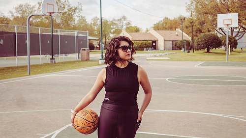 human woman standing outdoors holding basketball people