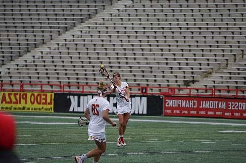 human women playing lacrosse people