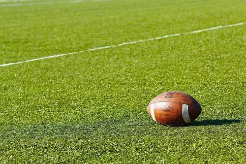 grass football on green field during daytime field