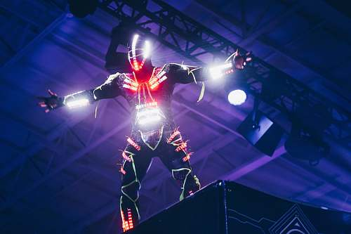 united states person wearing white and red LED light suit dance