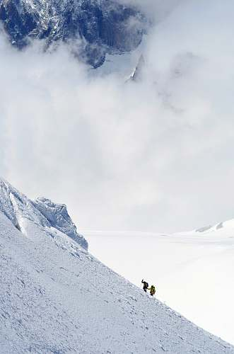 mountain two person hiking on snow-capped mountain mont blanc