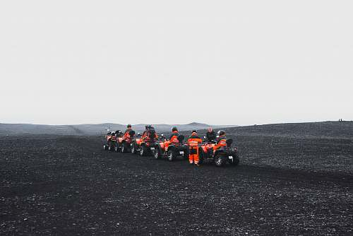 iceland group of people in orange suit riding a ATV black
