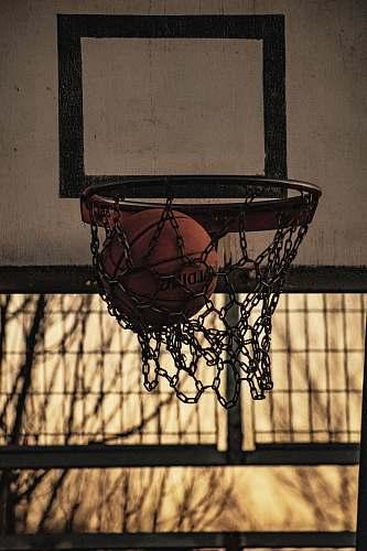 hoop red Spalding basketball ball inside basketball hoop sport