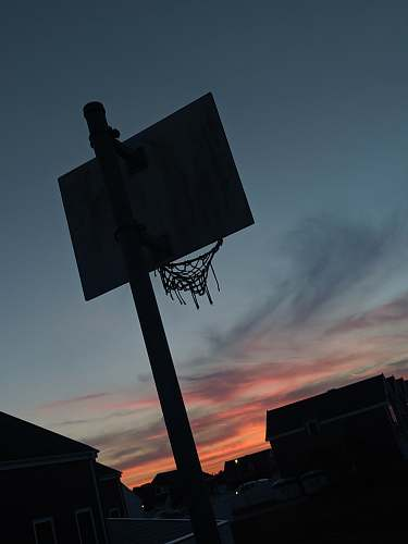 grey basketball system near house basketball