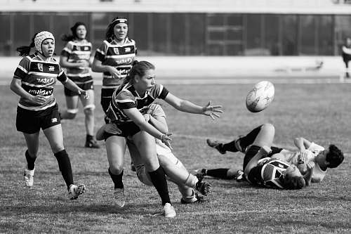 person grayscale photo of a woman playing soccer black-and-white