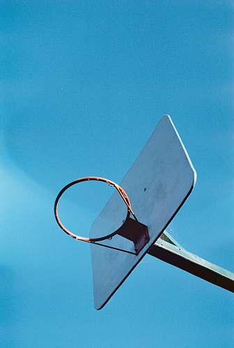 blue low angle photography of basketball hoop hoop