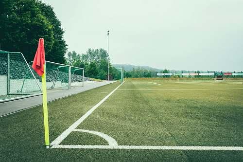 field minimalist photo of soccer field football