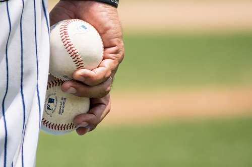 people person holding two baseballs baseball