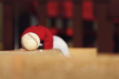 apparel shallow focus photo of white baseball clothing
