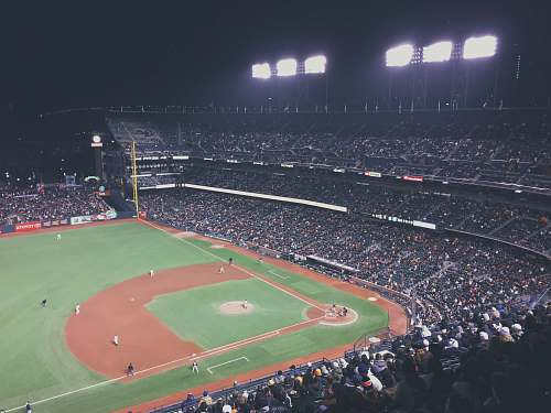 stadium baseball field during night time crowd