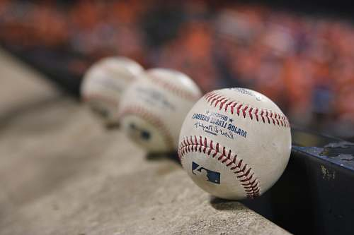 sport three white baseballs on gray textile baseball