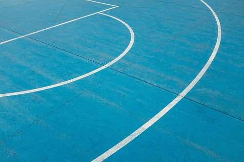 sport white painted lines on blue court floor team sport