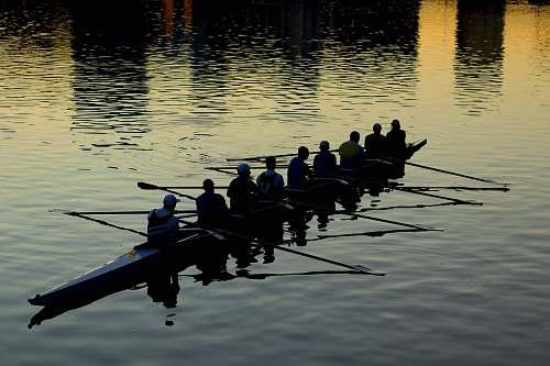 vehicle men rowing boat boat