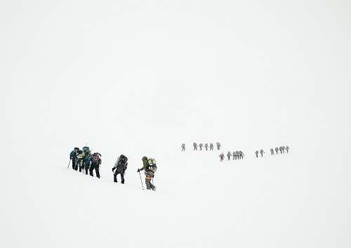 snow group of mountaineers hiking on snowy mountain people