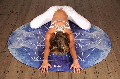 floor woman doing yoga stunt stretch