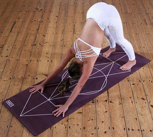 fitness woman stretching on yoga mat exercise