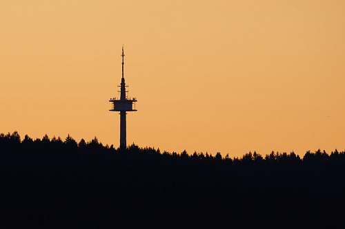 building silhouette photography of tower spire