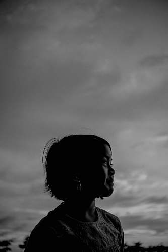 silhouette greyscale photography of girl person