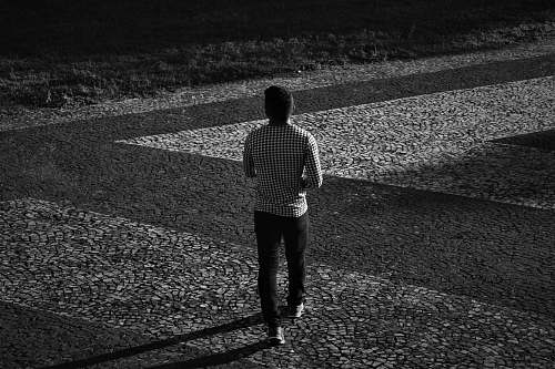 apparel man in plaid long-sleeved shirt and black pants walking clothing