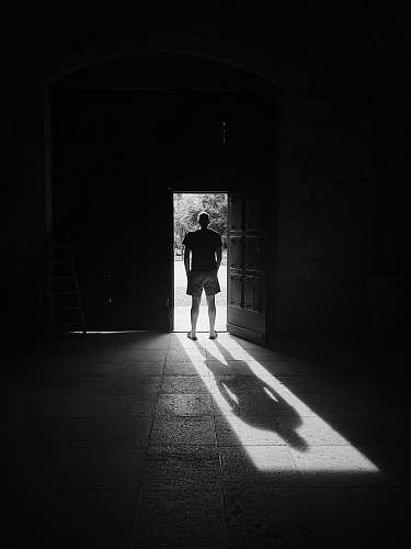 photo human man standing beside door person free for commercial use images