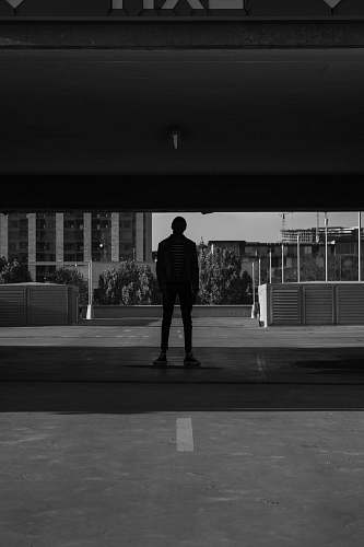 human man standing under the bridge person