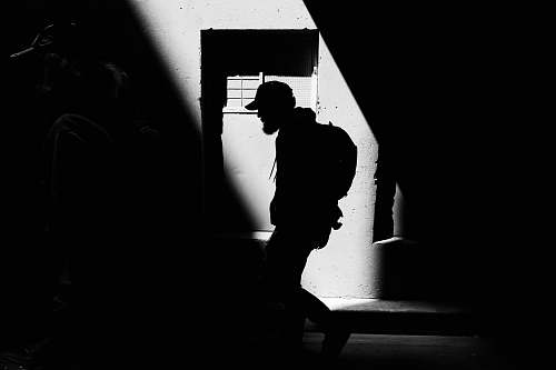 silhouette person carrying backpack walking on street melbourne