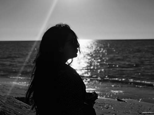 water silhouette of a woman at a beach nature