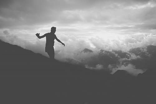 photo person silhouette of man on mountain hill grey free for commercial use images
