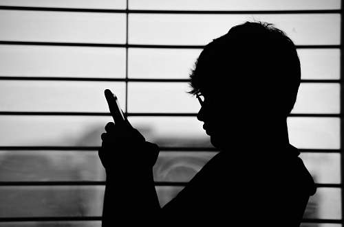 photo human silhouette of man wearing eyeglasses and holding phone person free for commercial use images