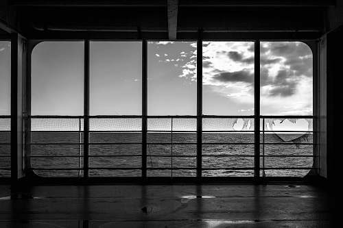 photo silhouette view of sea from glass wall floor free for commercial use images