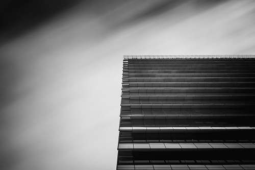 black-and-white low-angle and grayscale photography of curtain wall building office building