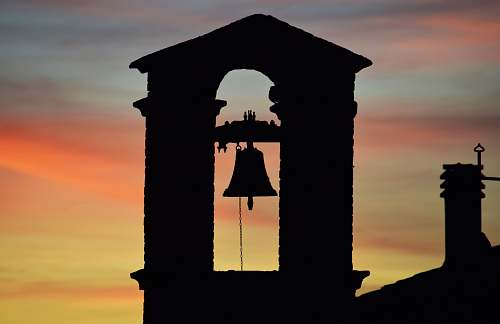 tower silhouette of church bell during sunset architecture