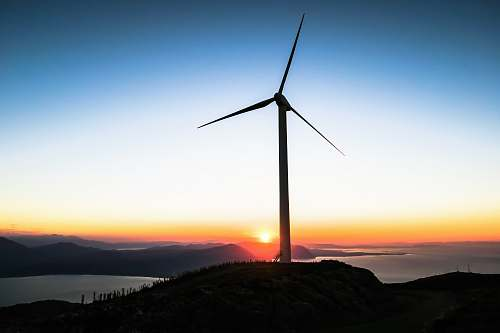 turbine silhouette of wind mill during golden hour wind