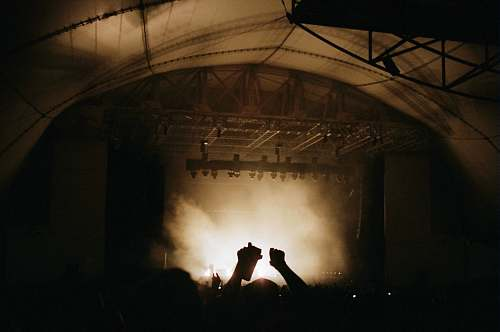 stage silhouette photography of group of people on concert music