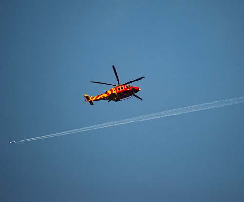 transportation red and yellow helicopter aircraft