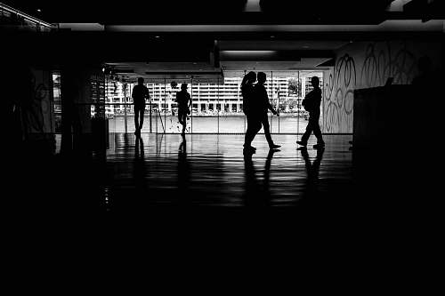 person gray-scale photo of people walking black-and-white
