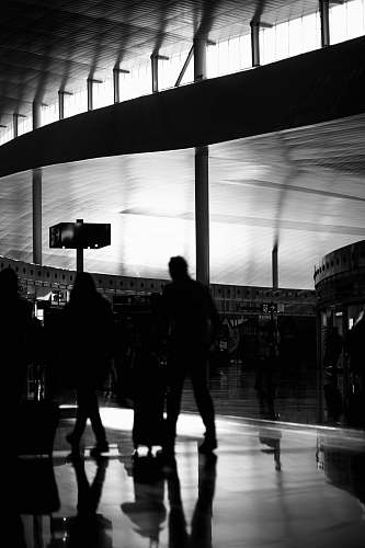 people grayscale photography of group of people walking black-and-white