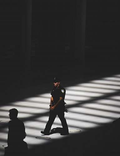 person man in black police uniform people
