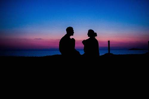 person silhouette of man and woman sitting people