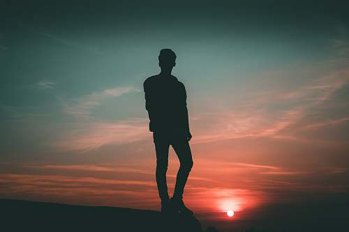 person silhouette of man standing during twilight people