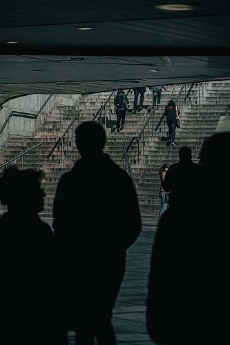 banister silhouette of people inside subway handrail