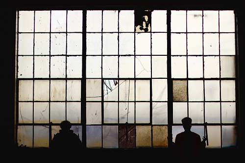 person silhouette of people standing near window people