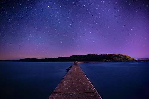 photo galaxy brown wooden dock under night sky pier free for commercial use images