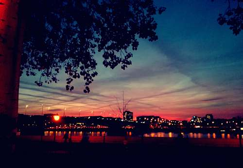 outdoors crimson sky over city by the bay at dusk sky