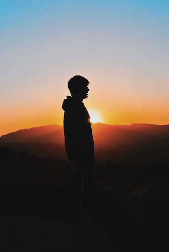 outdoors man wearing hoodie during golden hour sunset