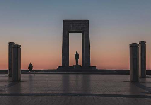 person person walking by monument during golden houre human