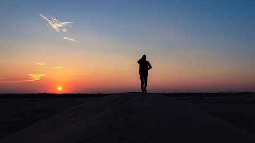 outdoors person walks on desert sky