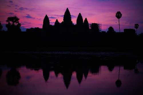 sunset silhouette of Ankor Wat silhouette